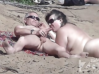 Blowjob on a nudist beach. amateur beach blowjob video
